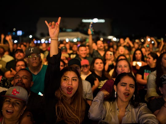 Audience members cheer as the Mavericks preform during Fiesta de La Flor on Friday, April 13, 2018.