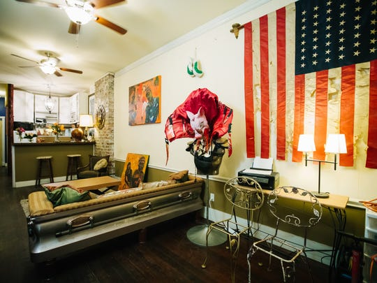 This home in the 2017 Weird Homes Tour New Orleans featured a temporary casket turned into a one-of-a-kind sofa.