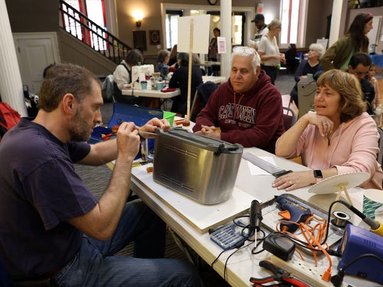 Sheree and Fred Newmark of Wesley Hills watch as repair