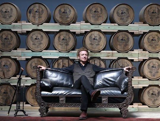Tommy Brunett in the barrel room at Iron Smoke Distillery