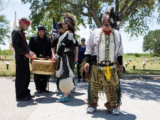Santos Hawk's Blood Suarez leads a Native Americans ceremony over Victor Castillo grave in the Memory Gardens Cemetery on Wednesday, May 9, 2018. Suarez had promised Castillo that he would perform the tribunal dance at the foot of his grave but do to his health he ask his son Tashunka to perform it for him.