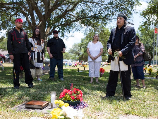 Santos Hawk's Blood Suarez gives a speech over Victor Castillo grave in the Memory Gardens Cemetery before preforming a Native Americans ceremony on Wednesday, May 9, 2018. Suarez had promised Castillo that he would perform the tribunal dance at the foot of his grave but do to his health he ask his son Tashunka to perform it for him.
