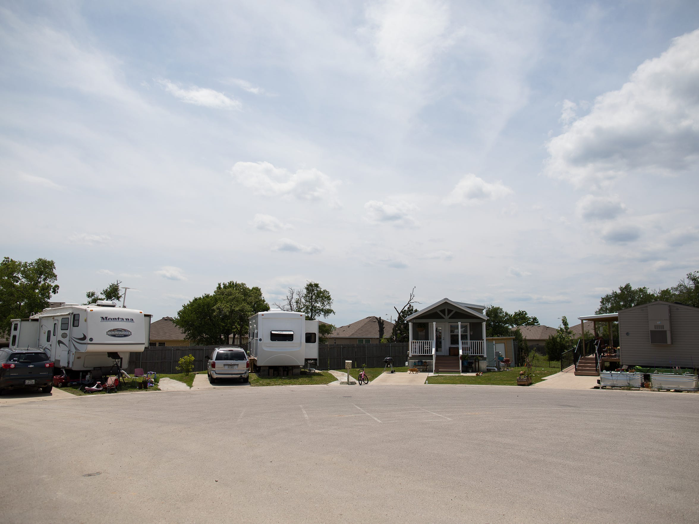 Homes and RV's parked at the end of street in the Community First! Village in Travis County Texas.