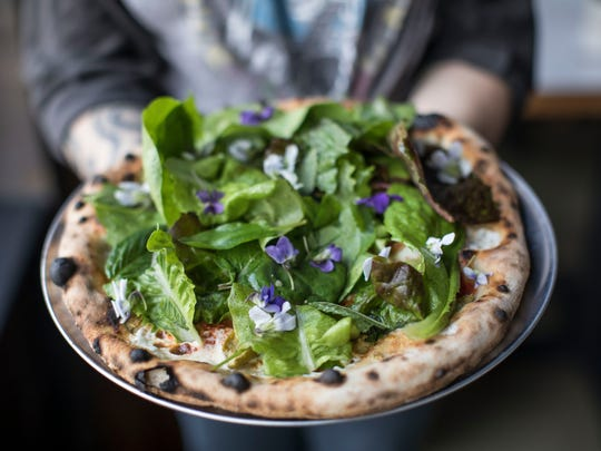 Pizza topped with greens at Folk, Philip Krajeck's