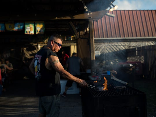 Milo Funtes grills steaks on the patio at Vernon's