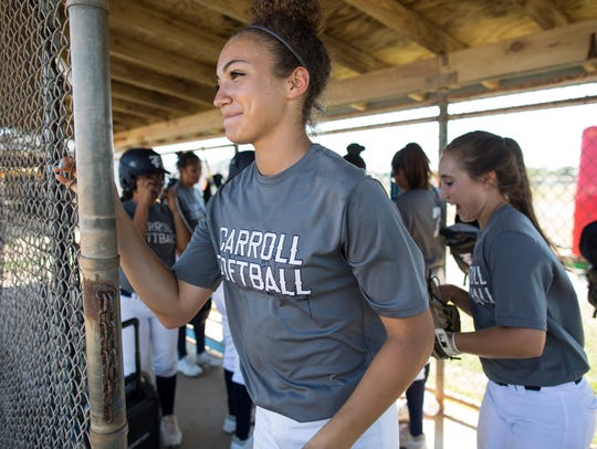 Carroll High School freshman pitcher Vanessa Quiroga walks out of the dugout during practice at the school's softball field on Tuesday, May 15, 2018.