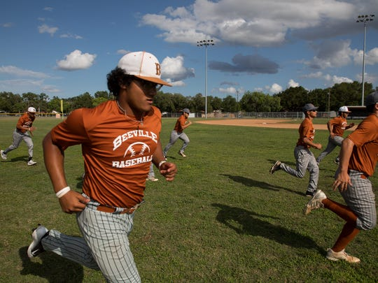 Beeville baseball players warmup at the start of practice at their high school on Wednesday, May 23, 2018.