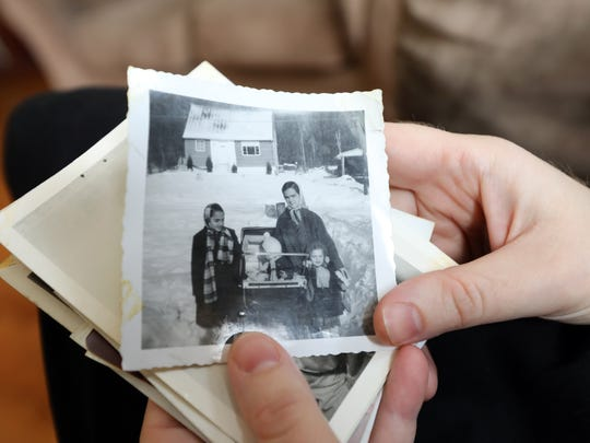 Chany Rosengarten shows a family photo of her grandmother,