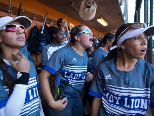 Santa Gertrudis Academy players cheer in the dugout