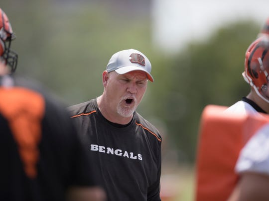 Cincinnati Bengals offensive line coach Frank Pollack yells during practice in the second week of OTAs at the Cincinnati Bengals practice facility in downtown Cincinnati on Tuesday, June 5, 2018.