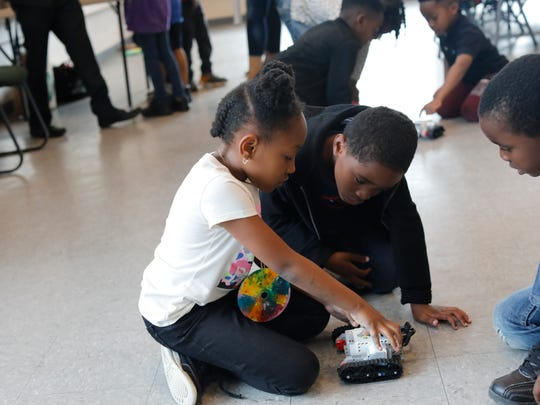 Students at the Slater Center STEAM program in White Plains play with some robots during an after school program on June 6, 2018.