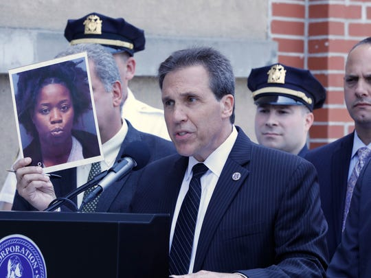 Yonkers Police Commissioner Charles Gardner holds up