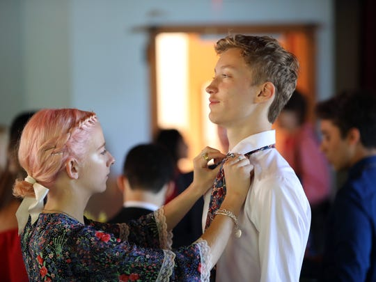 Lynne Scharf of Sparkill helps fellow graduate Karl Childs of Montrose with his tie before the Green Meadow Waldorf School graduation June 17, 2018 in Chestnut Ridge.