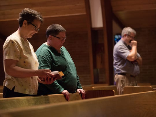 People attend a prayer vigil at All Saints' Episcopal