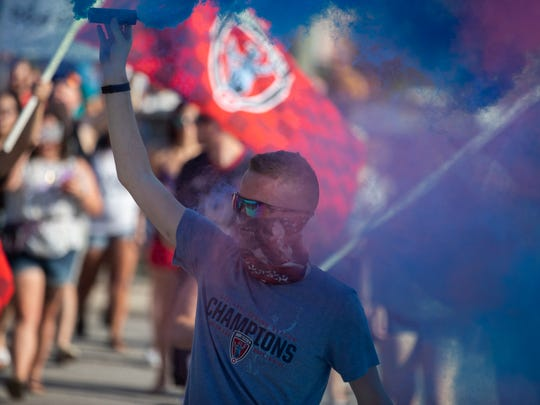 Fans celebrate before an Indy Eleven game.