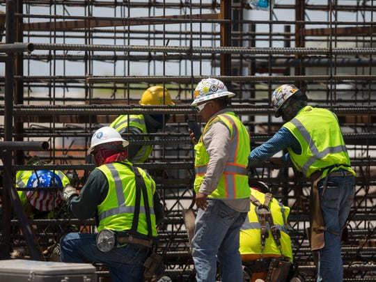 Construction crews work on the new Harbor Bridge project on Tuesday, July 3, 2018.