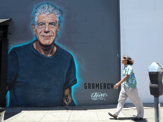 A recently painted mural in memory of culinary celebrity