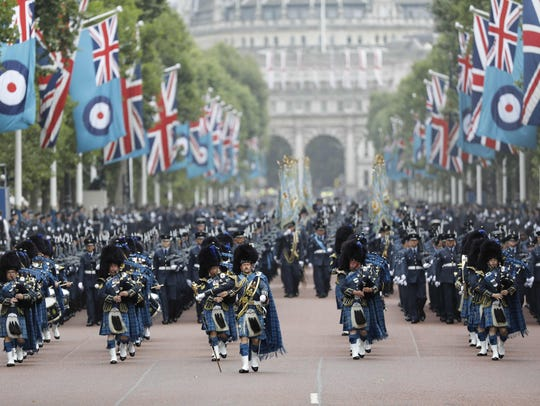 Royal Air Force personnel parade on The Mall toward