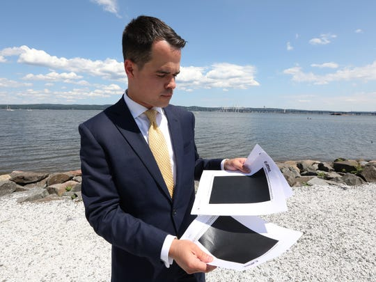 State Sen. David Carlucci, at Memorial Park in Nyack, calls on New York State to end the cashless tolling contract with Conduent July 12, 2018. He is showing the redacted pages he received of the state's contract with Conduent.