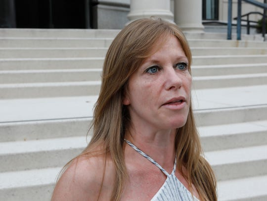 Dawn Byck of Ardsley reacts to the sentencing of Vedoutie