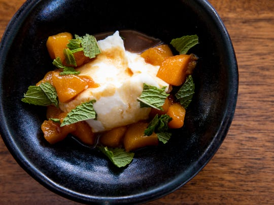 Brandied peaches and sweet ricotta prepared by chef Dallas McGarity at The Fat Lamb for the new Copper & Kings cookbook.
