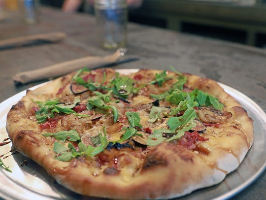 Fig Get about it pizza is made with fresh fig, capicola,