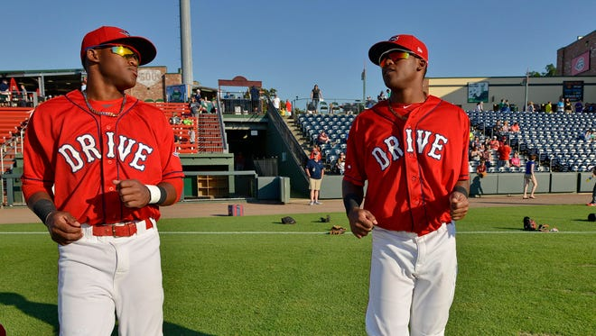 Luis Alejandro, left, and Luis Alexander Basabe are sharing their pro baseball dream this season with the Greenville Dive.