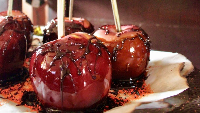 Even though you can't hand these out to trick-or-treaters nowadays, these candied apples are perfect for gifts or to serve at a Halloween party.