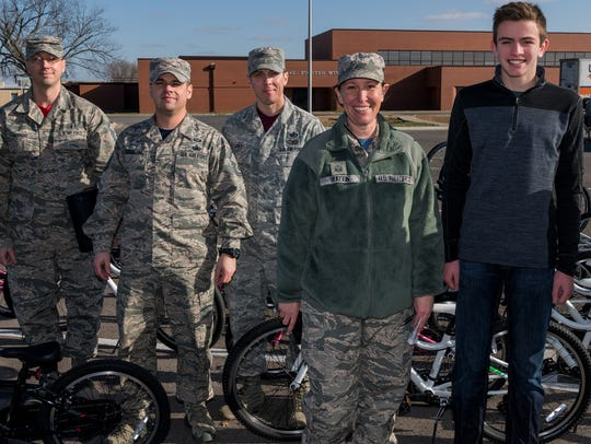 Garrett Litherland recently delivered 46 bicycles to Whiteman Air Force Base. He handed them off to a group at the base that works closely with families. They will be distributed to parents before the holiday.