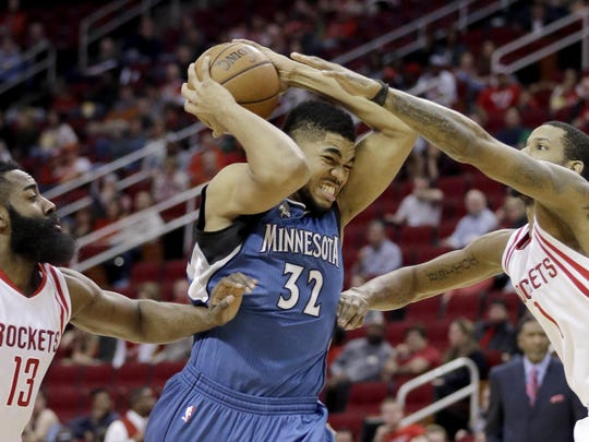 The Minnesota Timberwolves' Karl-Anthony Towns (32)
