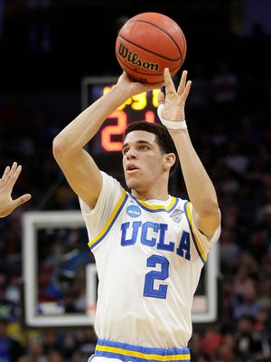 UCLA guard Lonzo Ball shoots against Cincinnati during the second half of a second-round game of the men's NCAA college basketball tournament in Sacramento, Calif., Sunday, March 19, 2017. UCLA won 79-67.