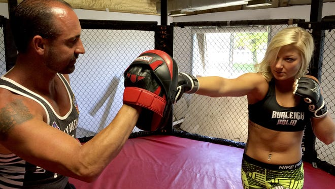 Cecelia Shuler, a 2013 Port Huron graduate, prepares for her first MMA fight, in 2015. She's been training with Amateur Fighting Club owner Aron Anglebrandt.