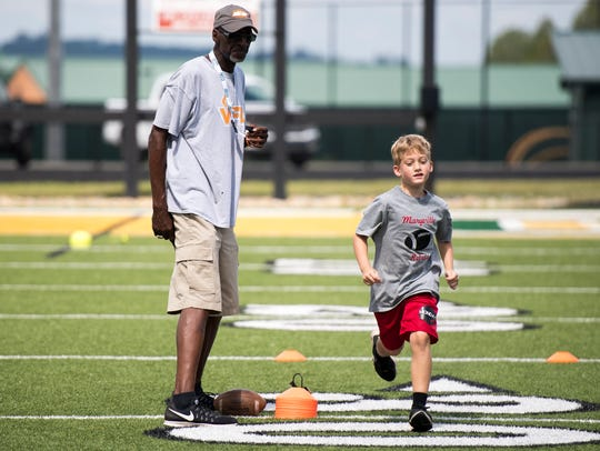 Former Vols quarterback Tony Robinson watches as children participate in a drill at the Legends of Tennessee football camp Thursday at Northview Academy in Kodak.