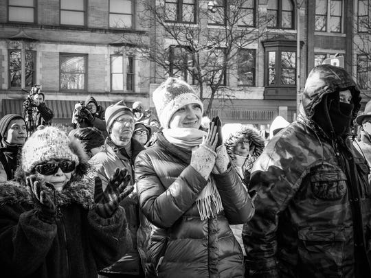 Supporters gathered in sub-freezing temperatures to watch Michael Helfrich be sworn in as the city's new Mayor stand to applaud, Tuesday Jan. 2, 2018. John A. Pavoncello photo