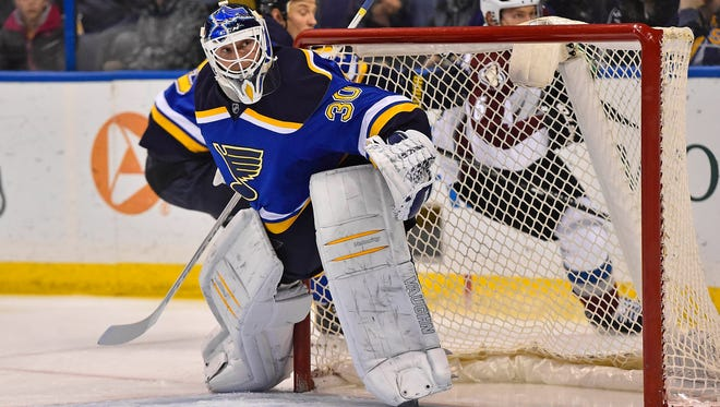St. Louis Blues goalie Martin Brodeur (30) watches the puck against the Colorado Avalanche during the first period at Scottrade Center.