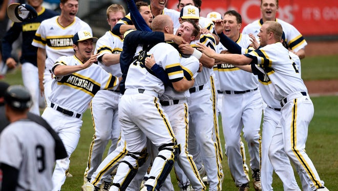 Michigan celebrates a 4-3 win in the NCAA Big Ten tournament championship college baseball game against Maryland, Sunday, May 24, 2015, in Minneapolis.