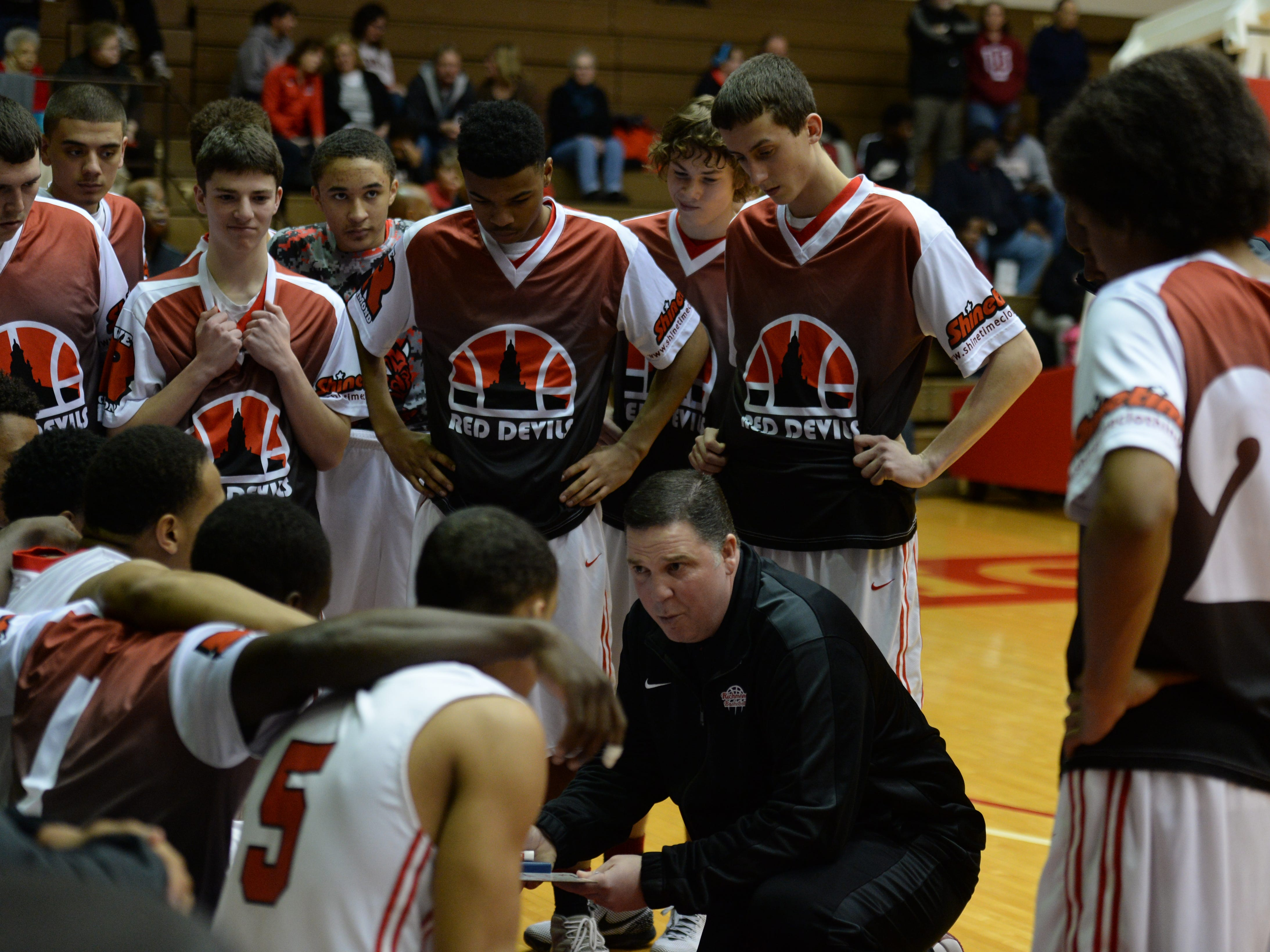 Richmond coach Joe Luce gives the team instructions before a game this season at Tiernan Center. Luce earned an Indiana Coach of the Year honor on Thursday.