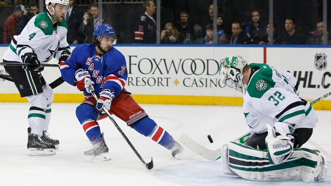 Dallas Stars goalie Kari Lehtonen of Finland makes a save in front of Stars defenseman Jason Demers and Rangers right wing Mats Zuccarello in the second period Sunday at Madison Square Garden.