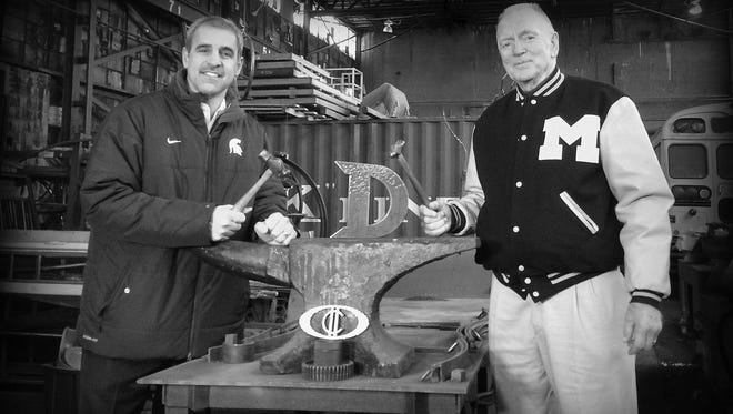 """Michigan State hockey coach Tom Anastos and Michigan coach Red Berenson with the new """"Iron D Trophy."""""""