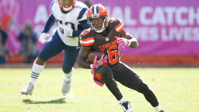 Cleveland Browns wide receiver Andrew Hawkins looks for an opening after catching a pass against the New England Patriots in the second half of an NFL football game Sunday, Oct. 9, 2016, in Cleveland. (AP Photo/Ron Schwane)