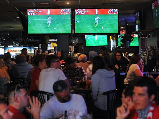 Television screens show a broadcast of the 2015 FIFA Women's World Cup Final between the U.S. and Japan on Sunday, July 5, 2015, at the Gateway Casino and Lounge in Sioux Falls.