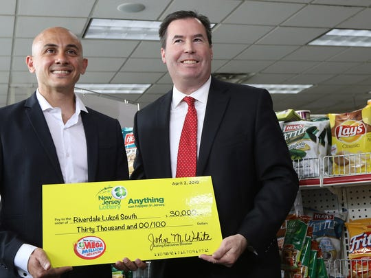 Ameer Krass, left, owner of Riverdale Lukoil South,