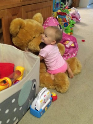 Isabella is always happy when she plays with Mr. Big Bear.