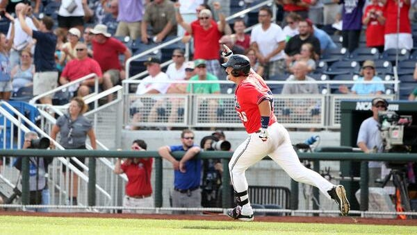 Ole Miss' John Gatlin celebrates his game-winning RBI single to beat Texas Tech on Tuesday at the College World Series.