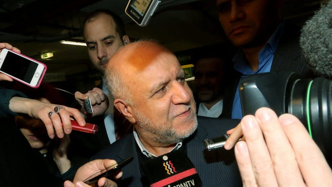 Iran's Minister of Petroleum Bijan Namdar Zangeneh talks to journalists as he arrives at a hotel for a meeting of the Organization of the Petroleum Exporting Countries, OPEC, in Vienna on Nov. 26.