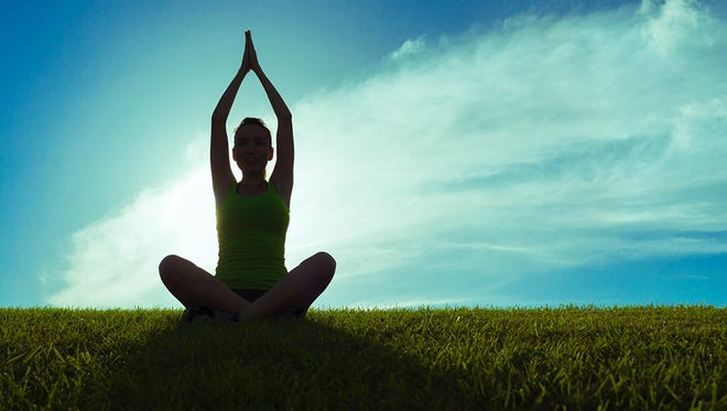 Get zen on your next vacation by practicing yoga and meditation.