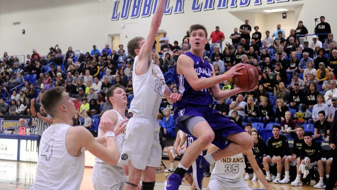 Wylie guard Dylan Isenhower (21) goes in for a shot against Seminole's Clayton Medlin (25) during the Region I-4A championship game at the Lubbock Christian University Rip Griffin Center on Saturday, March 3, 2018.