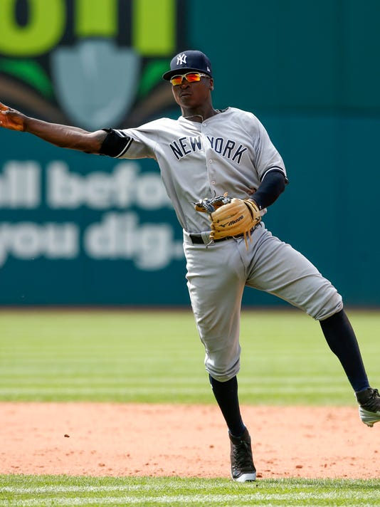 New York Yankees' Didi Gregorius throws out Cleveland Indians' Brandon Guyer during the ninth inning in a baseball game, Sunday, Aug. 6, 2017, in Cleveland. The Yankees won 8-1. (AP Photo/Ron Schwane)