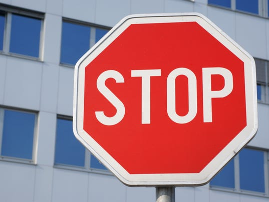 Stop sign in front of corporate building