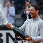 FILE - In this June 5, 2005, file photo, Spain's Rafael Nadal kisses the trophy after defeating Argentina's Mariano Puerta in their final match of the French Open tennis tournament, at the Roland Garros stadium, in Paris. Even as his 32nd birthday approaches, Nadal is as dominant a figure as anyone ever has been on any surface in tennis.(AP Photo/Michel Euler, File)
